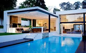 home swimming pools at night. Beautiful House With Courtyard Swimming Pool Level Slope Has Newest Homes Photo Nice Houses Pools Home At Night N