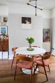 dark wooden flooring goes beautifully with pale grey walls in this dining room pinkchair
