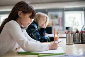 student sitting at desk side view. Contemporary Sitting Side View Of Students Writing On Paper At Desk In Classroom And Student Sitting At Desk View
