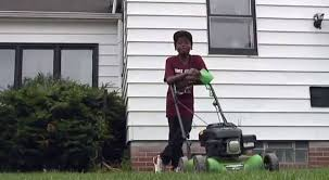 Neighbours Call Police On 12-Year-Old Boy Mowing Lawn - LADbible