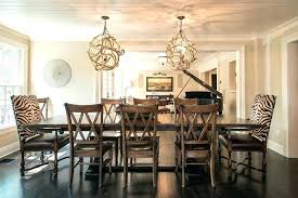 hanging two chandeliers over dining table tables