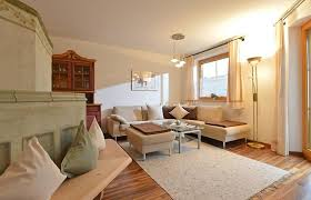 Wohnzimmer Mit Kachelofen Appartement Stroblfeld Going Am