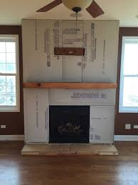a step by step diy stone veneer installation on a fireplace in only