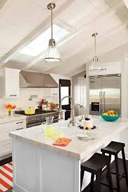 pitched roof lighting ideas. adorable cottage kitchen just enough colour to make it charming the vaulted ceilings and pitched roof lighting ideas r