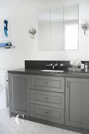 dark gray washstand with black granite countertop
