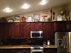 above kitchen cabinets ideas.  Kitchen How To Decorate Above Kitchen Cabinets 1000 Ideas About Cabinet Top  Decorating On Pinterest Farm Plans In V