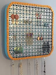 tidy up your trinkets with a diy wall jewelry organizer