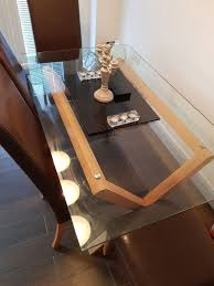 stylish glass top dining table and 4 chairs for