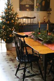COLONIAL DECORATING WITH GREENERY AND CITRUS AT CHRISTMAS.