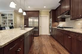 dark cabinets light countertops design