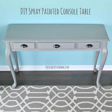 diy spray painted console table a little paint and elbow grease is an inexpensive way to change something that doesn t fit with the decor of your home and