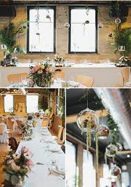 bridal party table with hanging flower filled glass ornaments
