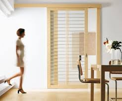 wonderful barn door sliding room divider with clear glass in light oak wood r e t r e a t sliding doors sliding door and room dividers