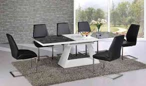 white high gloss extending dining table with 8 chairs set with black gl top
