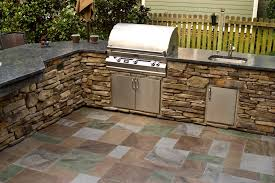 creative designs outdoor kitchen with stainless firetable featuring storage food combine and modern washbasin feat yellow color wooden fencing