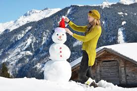 Download Girl decorating a snowman stock image. Image of scarf - 40431877