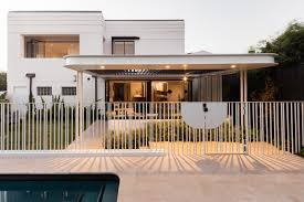 outdoor front yard trees stone patio porch deck and metal on dwell metal wall art with photo 1 of 11 in a heritage art deco house in australia gets a