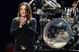 Big black shape with eyes of fire telling people their desire satan's sitting there, he's smiling watches those flames get higher and higher oh no, no, please god. My City Ozzy Osbourne Pulled From Black Sabbath Grammy Salute Over Ceremony Snub