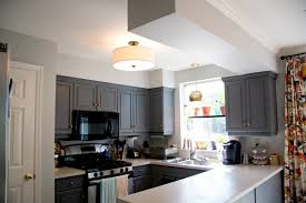 Charming Glitter And Goat Cheese   Kitchen With Gray Painted Cabinets And New Light  Fixtures Awesome Design