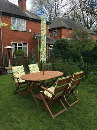 homebase peru oval wooden table and 4 chairs leaf parasol