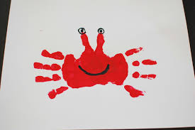 this crab painting was totally easy and so much fun just paint their hands red then press on the paper and once it is dry paint on the features of