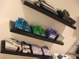 Floating console shelf Rustic Gaming Consoles On Floating Shelves Game Room Via Backward Compatible Video Game Blog Pinterest Gaming Consoles On Floating Shelves Game Room Via Backward