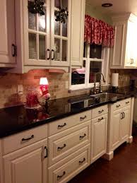 Off White Cabinets, Brazilian Marron Cohiba Granite Counter Tops, Dark Wood  Floor. My