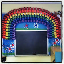 Rainbow bulletin board in my preschool classroom. Flowers made from recycled  materials by the kids