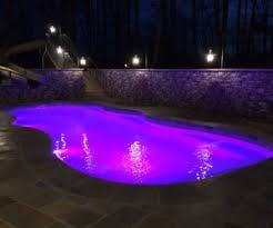 inground pools at night. A Picture Of True Kidney Inground Pool At Night With Led Lights Set On Blue Pools