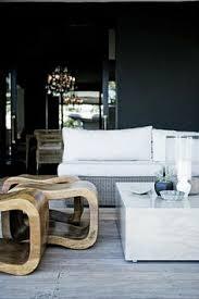 dark wall bright furniture love the drama