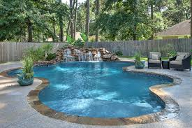 Peaceful Freeform Pool And Waterfall With Tanning Ledge By