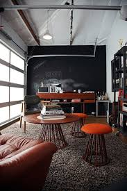 home office in garage. garage home office with midcentury and industrial vibe design amy sklar in e