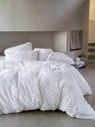 made from tufted cotton the drift white quilt cover set features a peaceful wave pattern in a superb chenile that is textural super soft and lightweight