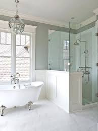 half wall shower enclosure master bath claw foot tub centered under the window glass to right 1
