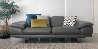 grey sofa and a 3 1 cushion arrangement with cushions in teal and mustard