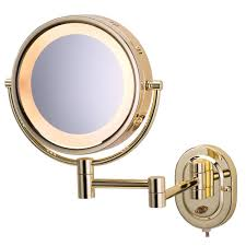 lighted wall mirror in bright brass