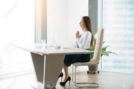 woman office furniture. Stock Photo - Young Woman Meditating At The Modern Office Desk, Finding A Time In Over-packed Schedule, Yoga As Habit And Necessary Requirement, Furniture N