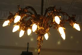 twelve light antique cast iron and brass chandelier for