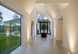 Nice clean soffits with uplighting by Mark English Architects