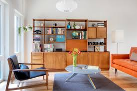 vintage bookcase living room scandinavian with orange sofa round wood coffee table round wood coffee table