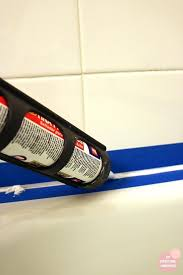 apply silicone caulk bathtub re caulking by oh everything can you use silicone caulk over grout apply silicone caulk