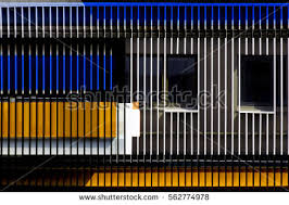 exterior louver. windows seen through jalousie / louvers blinds. building interior or exterior in blue, louver