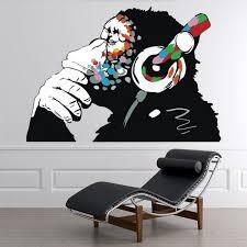 thinking monkey headphones banksy wall