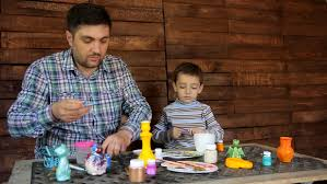 father and son by painting pottery hd stock clip