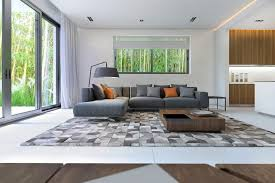 large brown plaid area rug put under square wooden coffee table also comfy grey sectional sofa