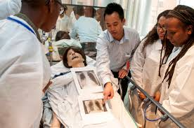 ymca teen achiever exposes youth to potential careers patrick smithedajkul md of the department of medicine and simulation fellow at the learning laboratory shows students x rays of their patient mannequin