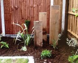 Garden Design Ideas With Railway Sleepers Three Upright Railway Sleepers Draw The Eye To The Corner Of
