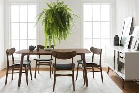 the gorgeous thao table is the perfect addition to any stylish dining room while the mid century modern
