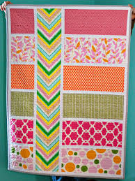 Bijou Lovely: colorblock quilt. & I love the colors in this one, girly but with a little bit of an edge to  it. The kelly green really pops in the chevron stripe. Adamdwight.com