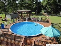 above ground swimming pool ideas. Here We See Another Deck All The Way Around A Round Above-ground Pool. Above Ground Swimming Pool Ideas